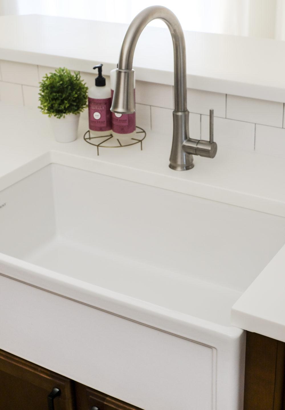 A closeup look at a white fireclay farmhouse sink