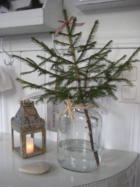 minimalist christmas tree decorations with a branch in a glass jar