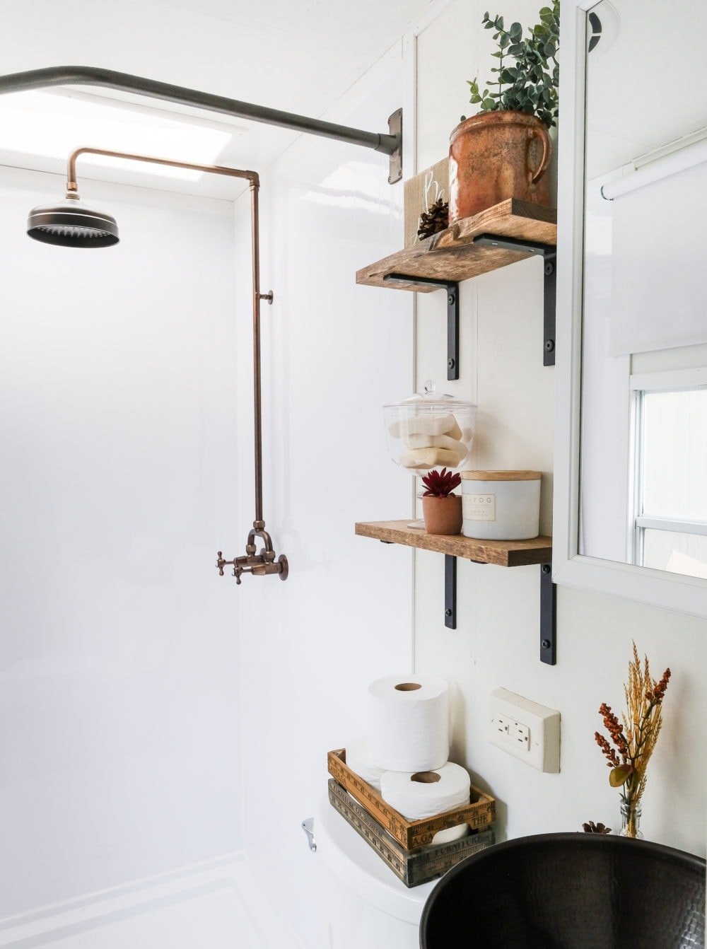 RV bathroom remodel with copper fixtures and open shelving