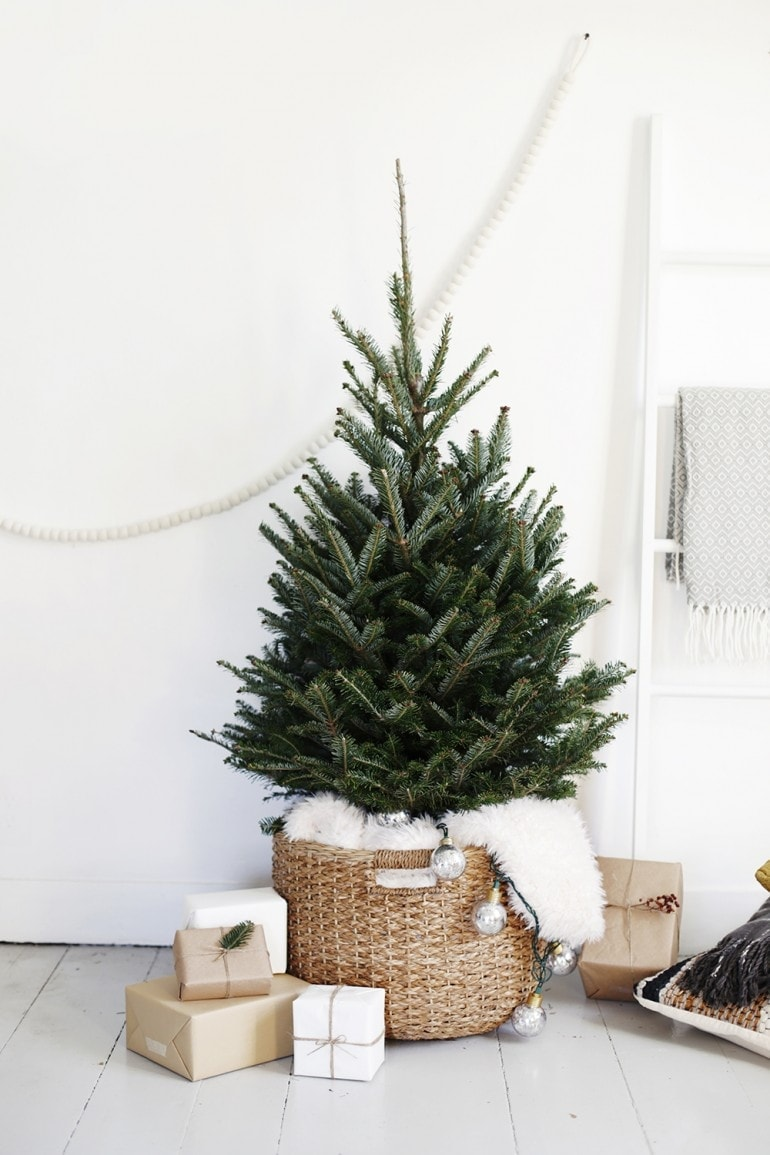 minimalist christmas tree with no ornaments in a woven basket