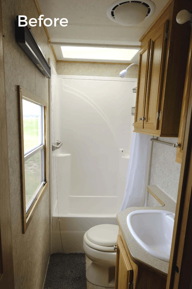 RV bathroom remodel before photo with original fixtures and oak cabinets