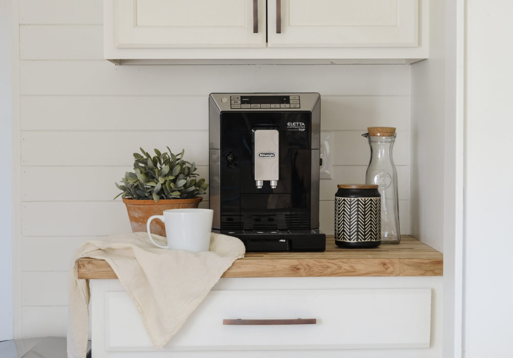 RV kitchen remodel with an espresso machine in front of a shiplap wall