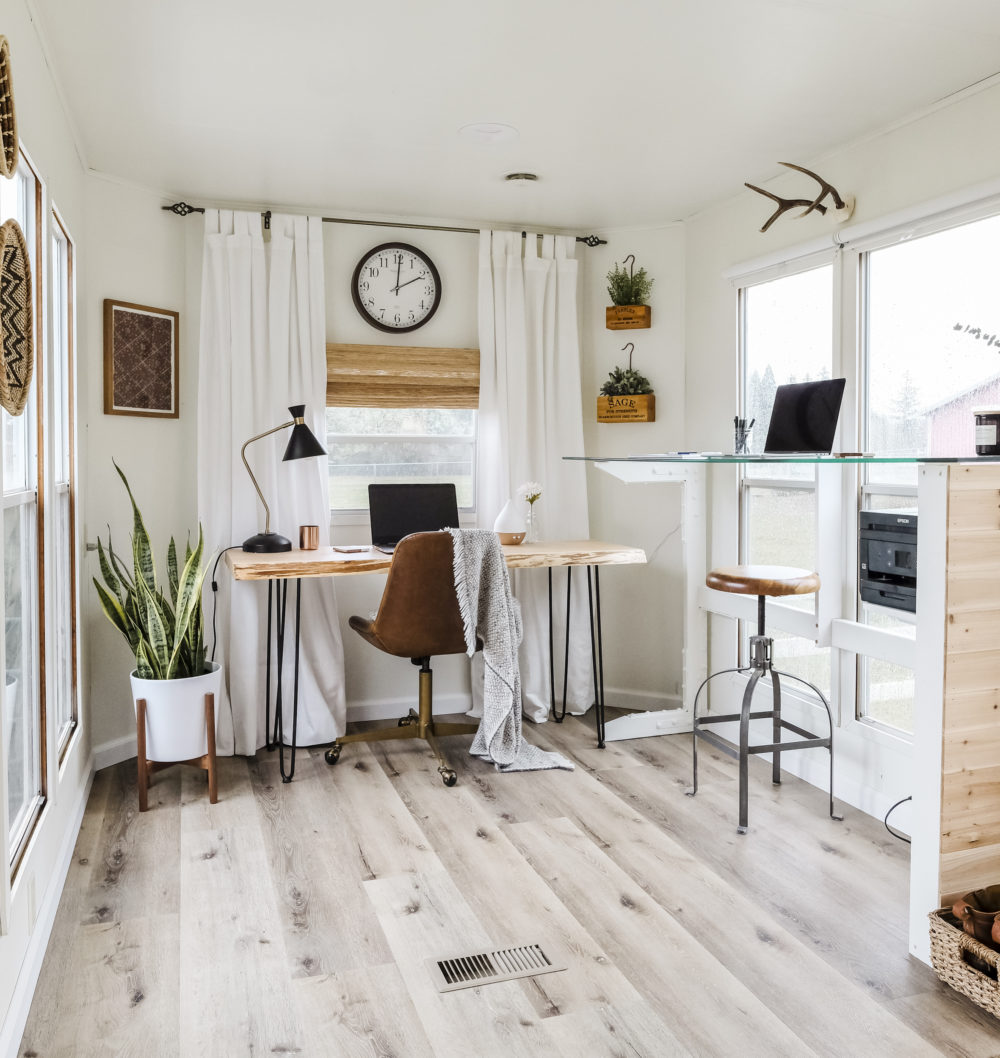 Small home office design with two desks and large windows