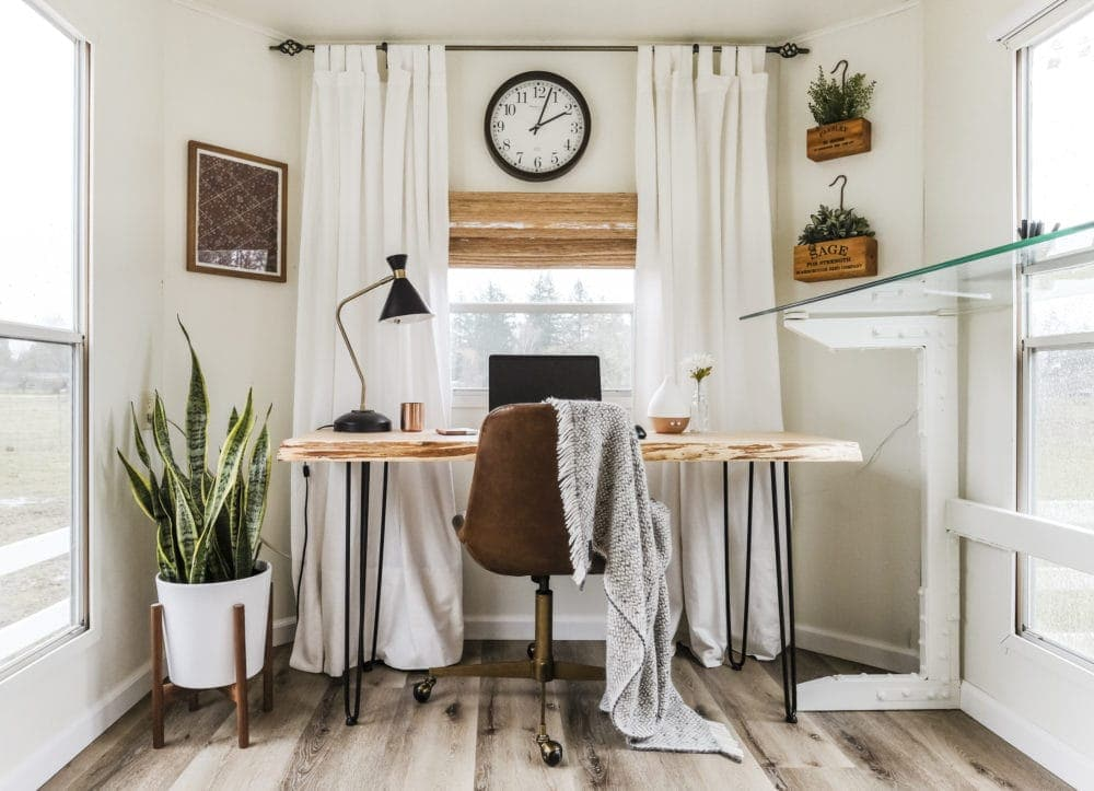 RV home office makeover with white walls, curtains and a wood desk