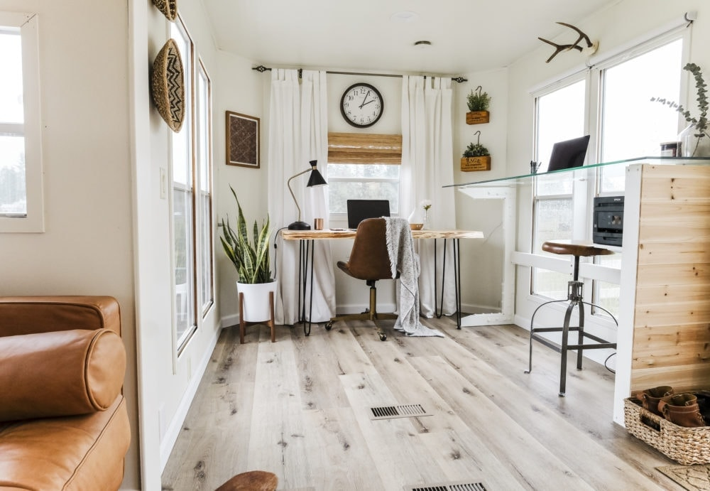 Home office inspiration with white walls, wood floors and two desk areas