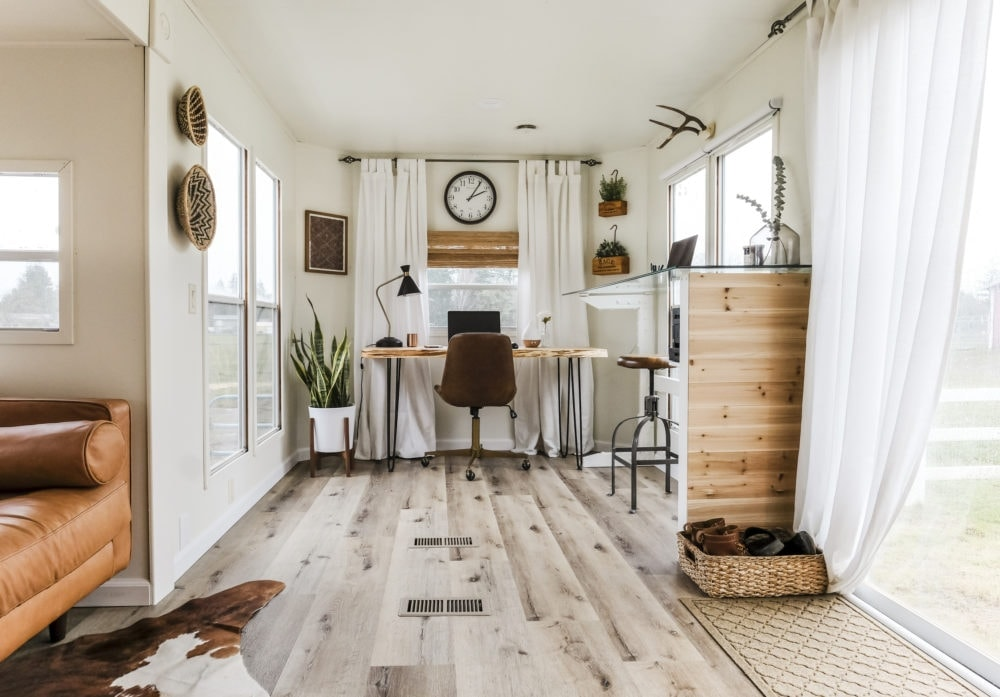 Home office inspiration for open concept living space and work space with two work stations