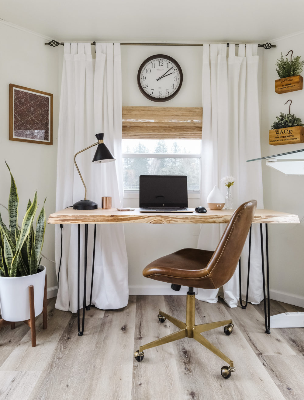 Home office space with modern desk and leather office chair