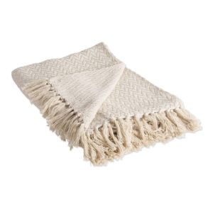 off white cotton throw blanket with subtle pattern and fringe detail