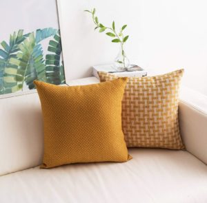 textured mustard yellow throw pillows set of 2 styled in a coastal style decor setting