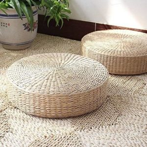 knitted straw floor cushion on a jute rug