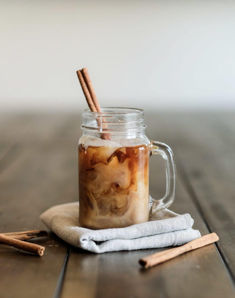 cold brew coffee in a mason jar with a cinnamon stick