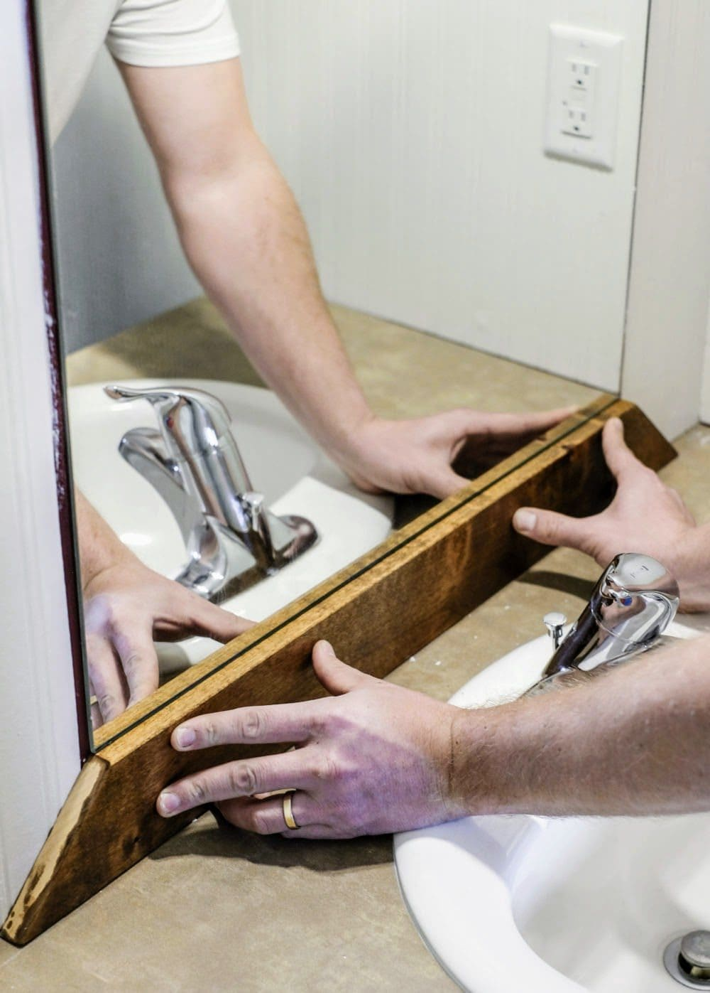adding a diy wood frame to a bathroom mirror