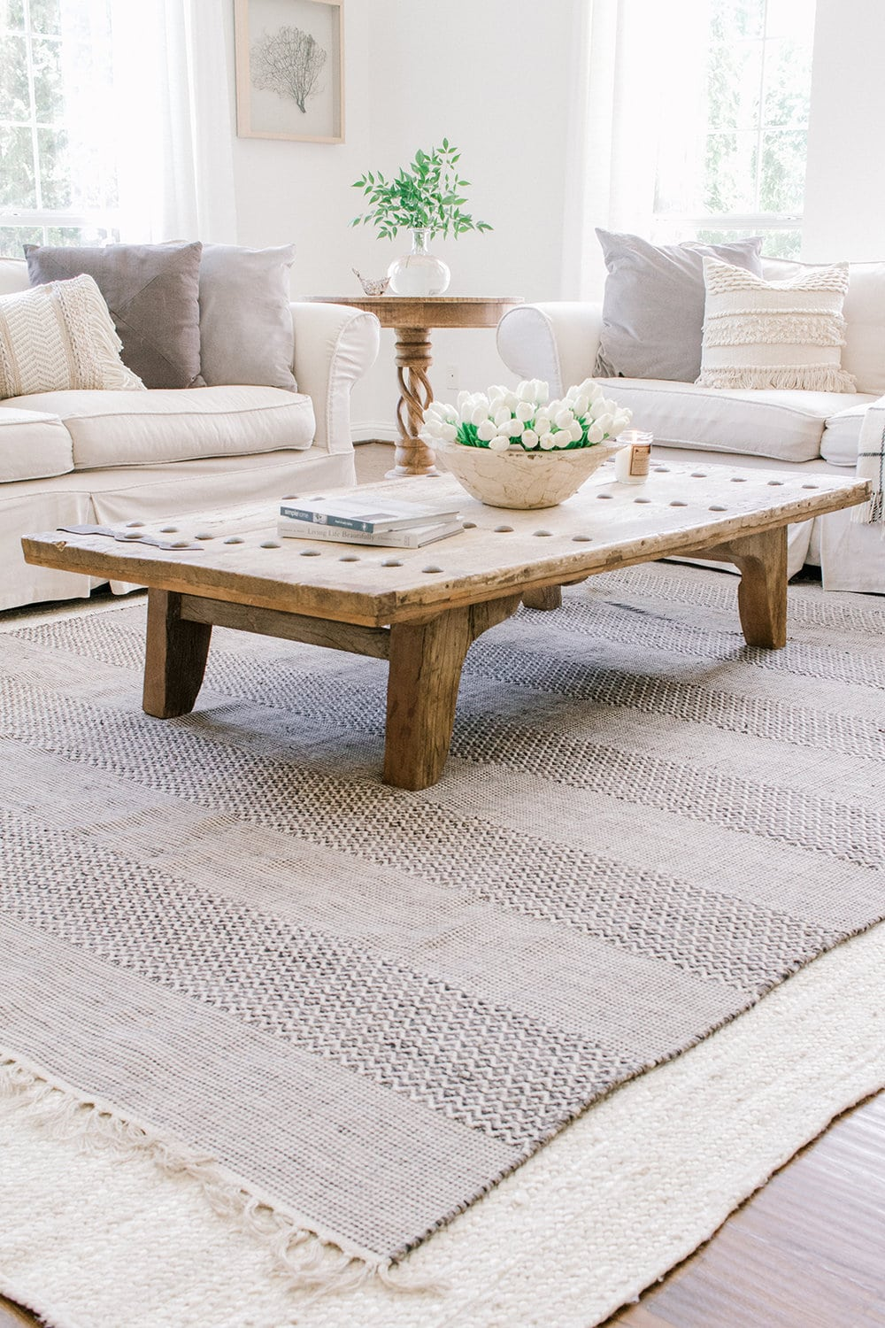 living room with layered rugs
