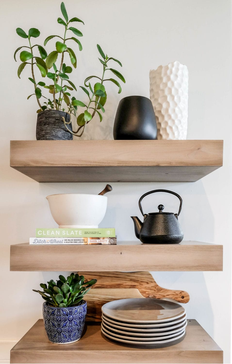 wood open shelving with decor