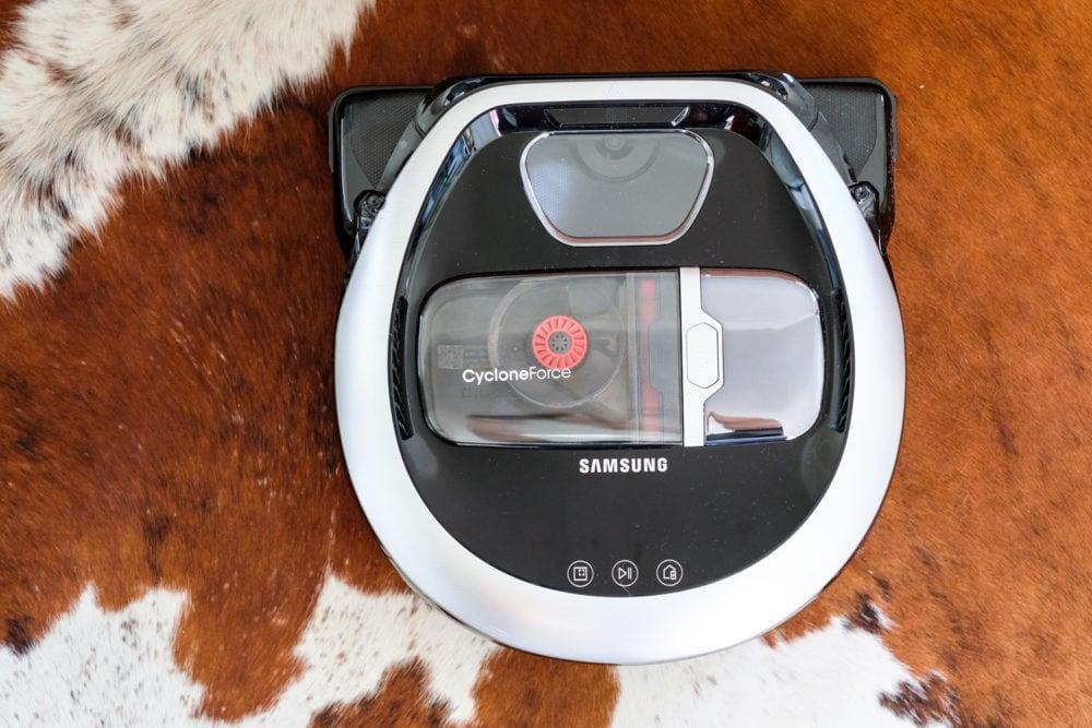 Samsung POWERbot robot vacuum on a cowhide rug