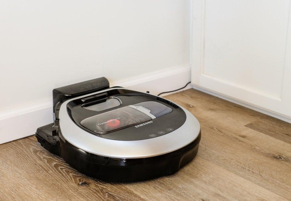 a Samsung POWERbot vacuum recharging at its docking station