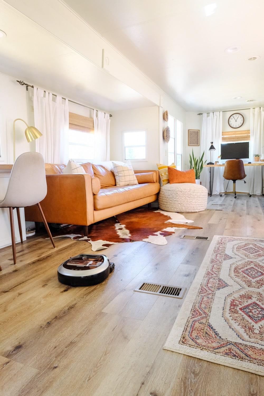 Samsung robot vacuuming wood plank floors