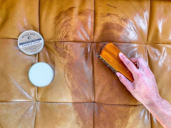 cleaning a spill off a leather sofa