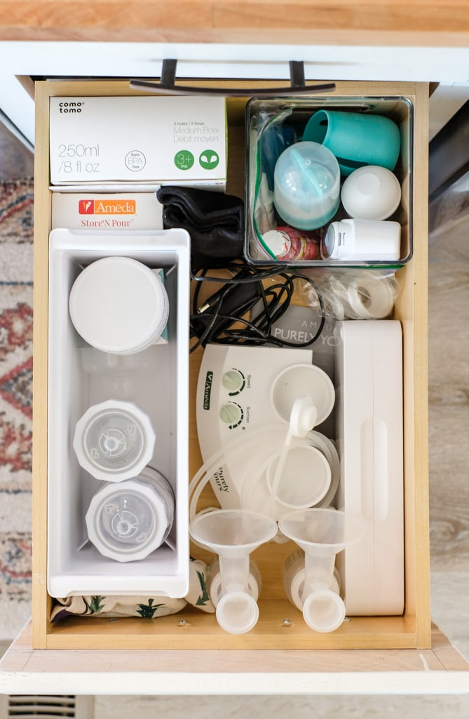 baby items organized in a kitchen drawer