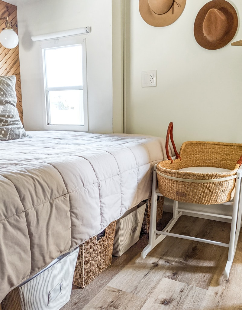 Moses basket in a small bedroom