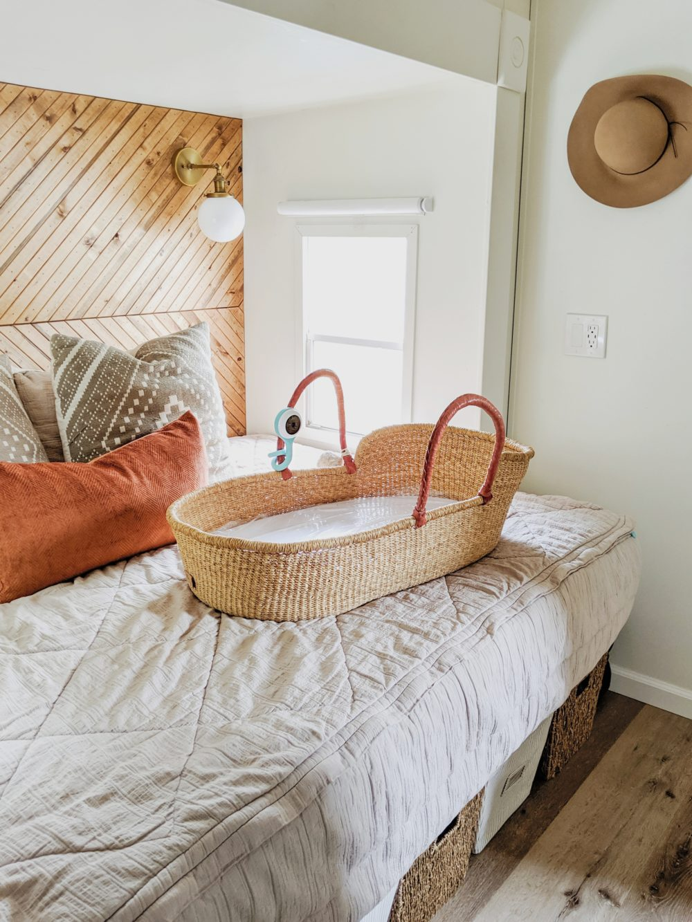 Moses basket on a bed
