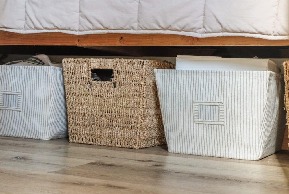 baby organization storage baskets under a bed