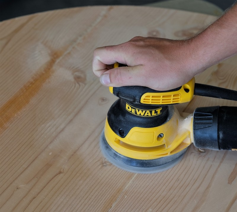 "Sanding a tabletop with a Dewalt 5"" sander"