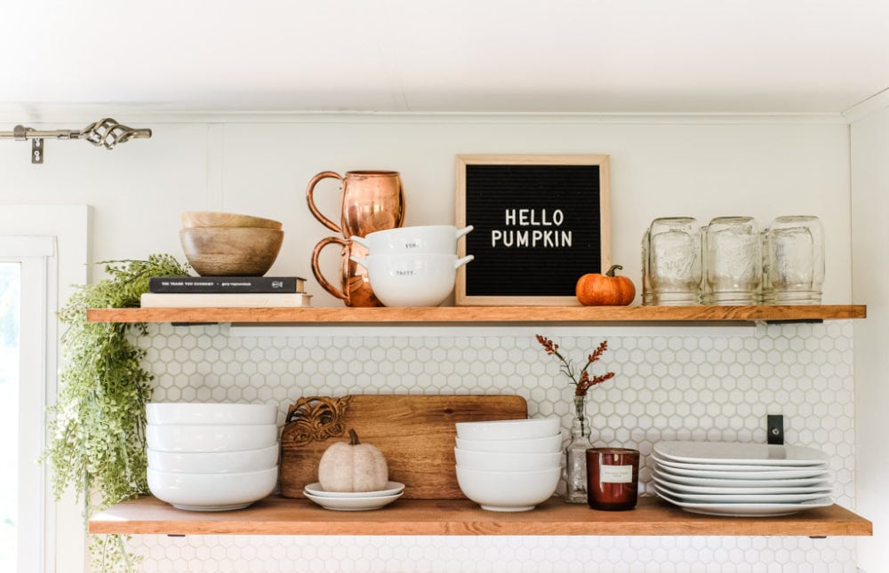 kitchen open shelving decorated for fall