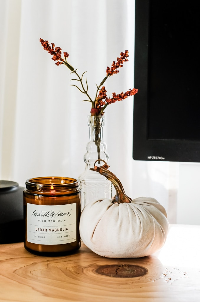 decorating for fall with a candle and linen pumpkin