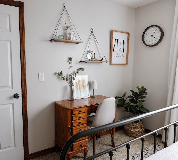 a bedroom painted gray with Pale Oak by Benjamin Moore