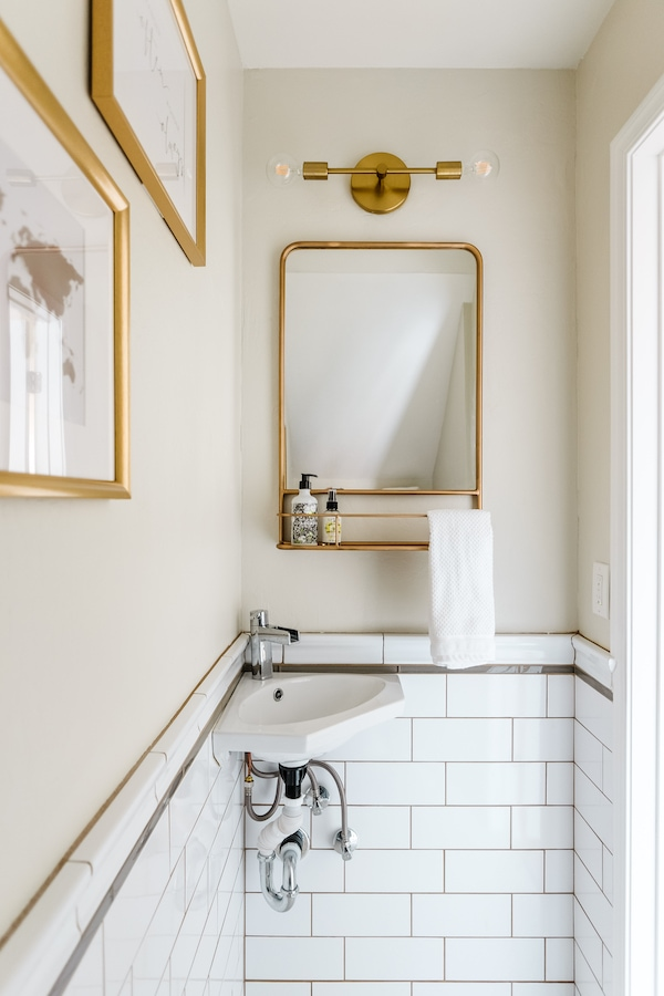 subway tile wainscoting in a bathroom